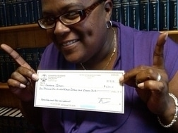 Dover personal injury victim receives $1,111.11 settlement check on 11
